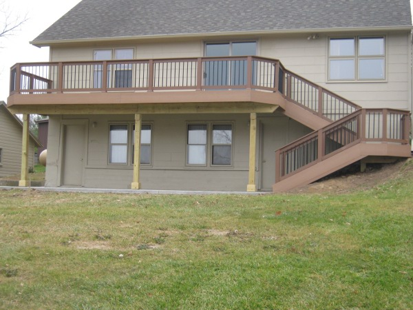 Two-story lakehouse deck with split stairs