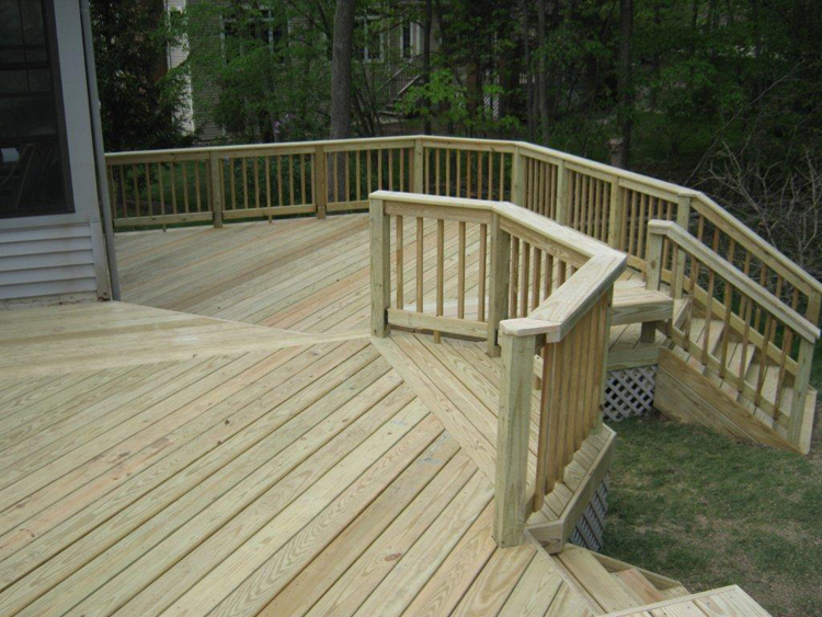 Wood or composite that is the question archadeck of for Pressure treated decking