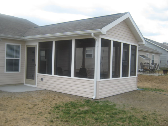 Swinging in the rain in this new ft wayne screened porch for Screen porch plans online