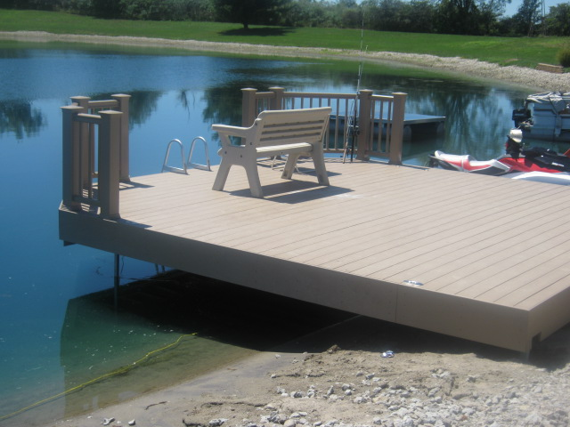 This unique pond deck also serves as a dock for this ft for Pond pier plans