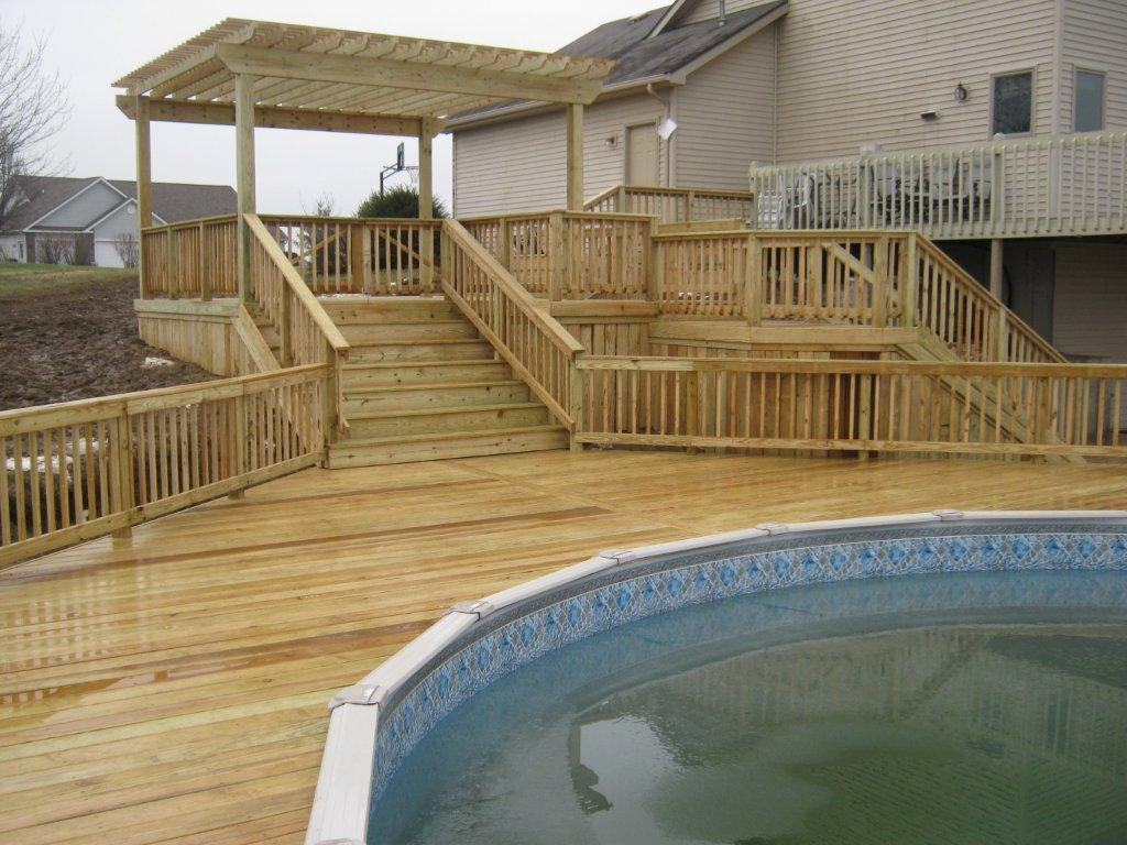 Have archadeck of ft wayne build your pool deck for Above ground pool decks photos